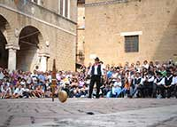 Gioco del Cacio al Fuso, the cheese rolling competition in Pienza